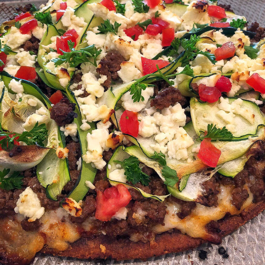 Healthy Cauliflower crusts pizza with Mediterranean toppings