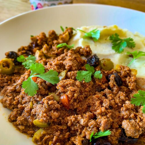 Ground beef picadillo with a side of mashed potatoes