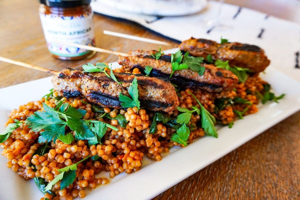 lamb kebabs with Moroccan flavors and a delicious couscous infused with Moroccan-inspired flavor