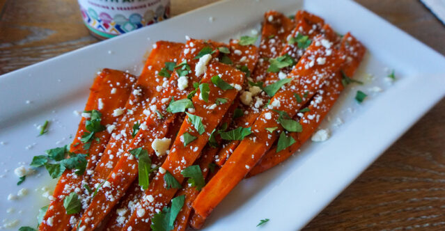 Tender carrots braised in a sauce with Moroccan flavors, with crumbled feta cheese on top